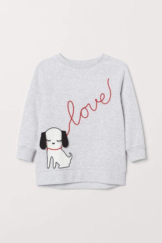 Soft with a motif and appliqués Sweatshirt AZ01